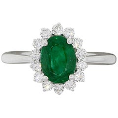 Oval Shape Emerald and Round Brilliant Diamond Halo Ring