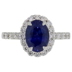 Oval Sapphire and Round Brilliant Diamond Ring
