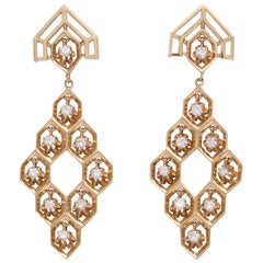 Dangling Diamonds in a Gold Honeycomb