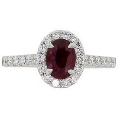 Oval Shape Ruby and Round Brilliant Diamond Ring
