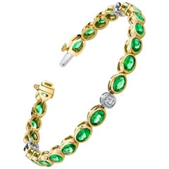 Tsavorite Garnet and Diamond 18k White and Yellow Gold Bezel Set Tennis Bracelet
