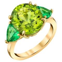 6.44 ct. Peridot Oval and Tsavorite Garnet Trillion 18k Yellow Gold 3-Stone Ring