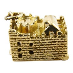 9 Karat Yellow Gold Articulated Castle and Cannon Charm
