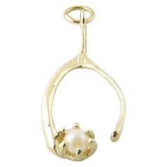 14 Karat Yellow Gold and Seed Pearl Wishbone Charm