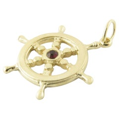 14 Karat Yellow Gold and Synthetic Ruby Ship's Wheel Pendant