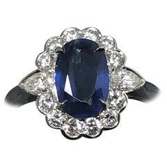 Sapphire 1.85 Carat and Diamond Cluster Ring Mounted in Platinum