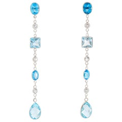 White Gold Blue Topaz Dangle Earrings
