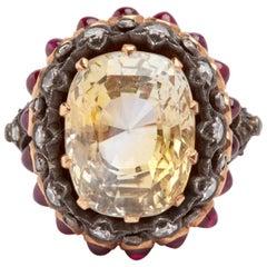 Yellow Gold Yellow Sapphire, White Diamonds and Cabochon Rubies Ring
