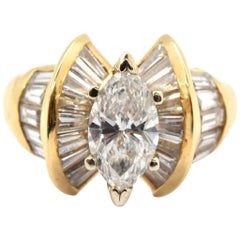 14 Karat Yellow Gold and EGL 1.20 Carat Marquise Diamond Ring with Baguettes