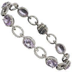 White Gold 11.75 Carat Oval Amethyst and Diamond Halo Tennis Bracelet