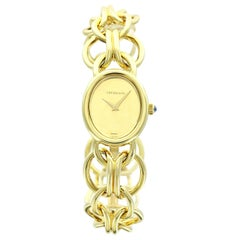 Tiffany & Co. Ladies Yellow Gold Champagne Dial Bracelet Watch