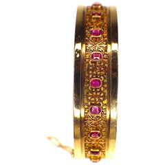 GEMOLITHOS Antique Pink Sapphire Gold Bangle, 1900s