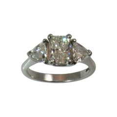 Platinum Ring with Radiant Cut Diamond and Diamond Trilliants