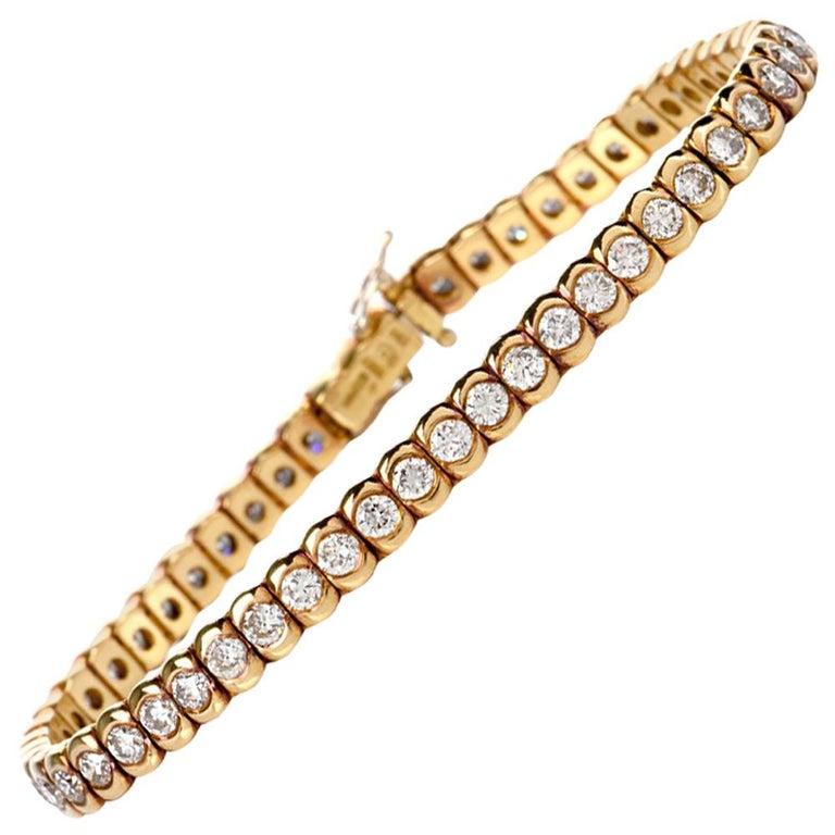1990s Italian Tennis 4.85 Carat Diamond 18 Karat Yellow Gold Bracelet For Sale
