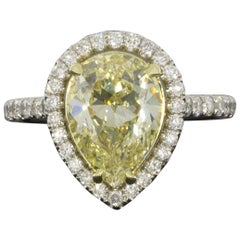 Platinum and Gold Fancy Yellow Pear Diamond EGL Certified Halo Engagement Ring