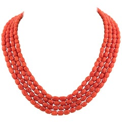 Four single-strand coral bead necklaces