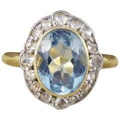 Antique Edwardian Aquamarine and Diamond Cluster Ring in 18 Carat Gold