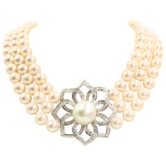 18 Karat Triple Strand Pearl Necklace with Diamond and South Sea Pearl Pendant