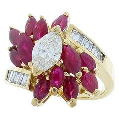 0.70 Carat Marquise Diamond, Marquise Rubies and Baguette Diamond Cocktail Ring