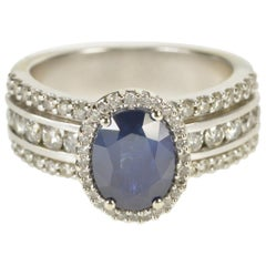 Oval Sapphire Diamond Halo Engagement Ring