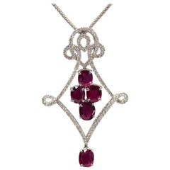 Ruby Oval and White Diamond Round Pendant Necklace in 18 Karat White Gold