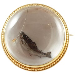 Early 20th Century 14 Karat Reverse-Carved Crystal Intaglio Fishing Brooch