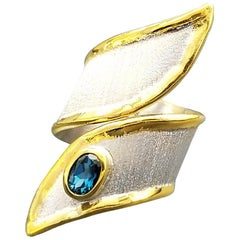 Yianni Creations 0.57 Carat Blue Topaz Fine Silver and 24 Karat Gold Ring
