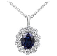 Oval Cut Blue Sapphire and Diamond Halo Pendant Necklace