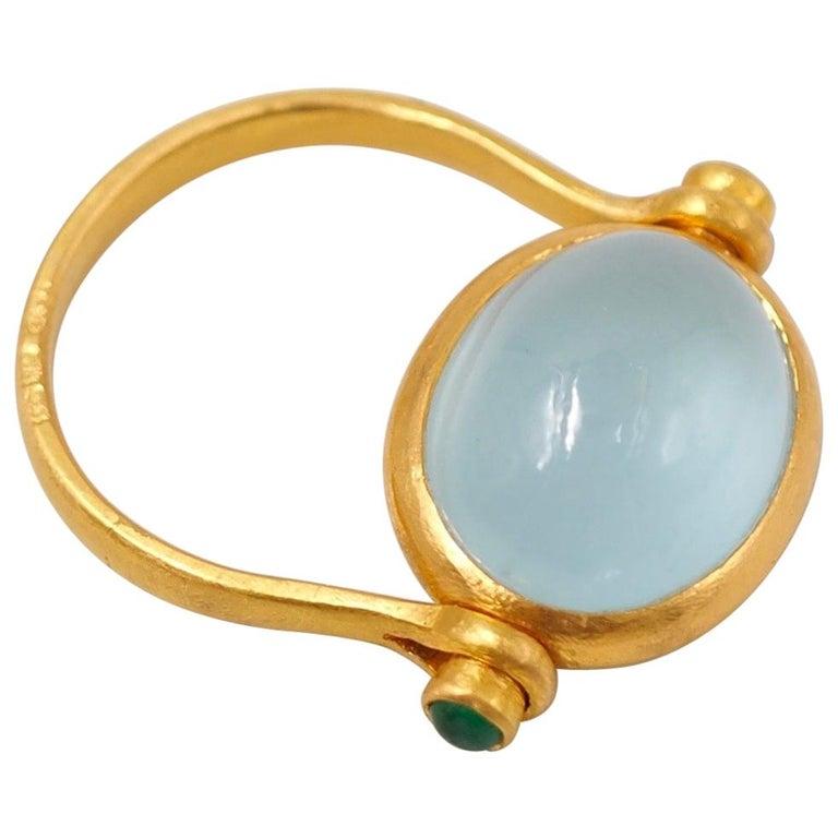 Scrives Aquamarine Emerald Cabochon 22 Karat Gold Turning Ring For Sale