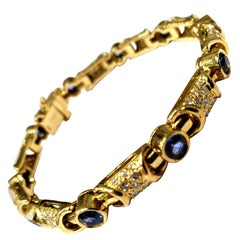 18 Karat Yellow Gold and Diamond Link Bracelet with Bezel Set Blue Sapphires