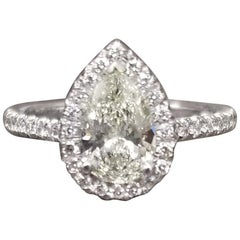 1.00 Carat Pear Shape Diamond with Diamond Halo