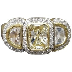 "1.09 Carat ""Yellow"" Emerald Cut Diamond with 2 ""Half Moons"""