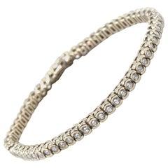 14 Karat White Gold Half Bezel Diamond Tennis Bracelet
