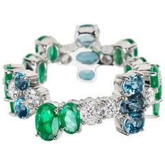 Nikos Koulis 18 Karat White Gold Emerald White Diamond Blue Topaz Band Ring