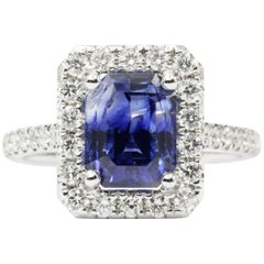 14 Karat White Gold 3.97 Carat Natural Blue Sapphire and Diamond Halo Ring