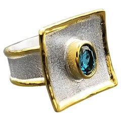 Yianni Creations 1.60 Carat Blue Topaz in Fine Silver 24 Karat Gold Ring