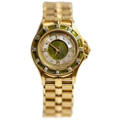 Mouboussin 18 Karat Yellow Gold Ladies Watch with Peridot and Diamonds