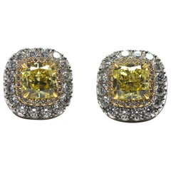 GIA Certified Fancy Intense Yellow Diamond Earrings Mounted in Platinum and Gold
