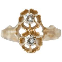 1940s 0.30 Carat Total Diamond and 14 Karat Yellow Gold 'Toi et Moi' Ring