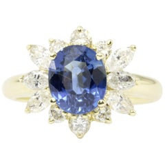 Yellow Gold 2.5 Carat Natural Sapphire and Diamond Halo Ring