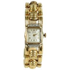Ladies Retro 18 Karat Yellow Gold and Diamond Bracelet Watch, circa 1940s