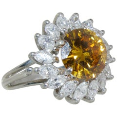 Cognac colored Diamond surrounded by fine  White Diamond in a Platinum Ring
