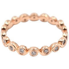 0.30 Carat Diamond 14 Karat Rose Gold Swirl Style Eternity Band