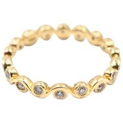 0.30 Carat Diamond 14 Karat Yellow Gold Swirl Style Eternity Band Ring