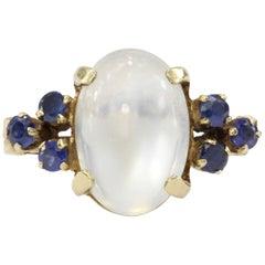14 Karat Yellow Gold 4 Carat Moonstone and .24 Carat Blue Sapphire Ring