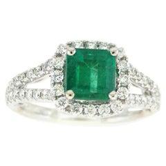 18 Karat White Gold Emerald Cut Emerald and Diamond Ring