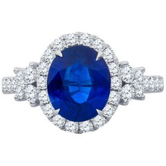 2.70 Carat (AGL)Natural Blue Sapphire, 0.84 total weight Diamonds in 18kw Ring