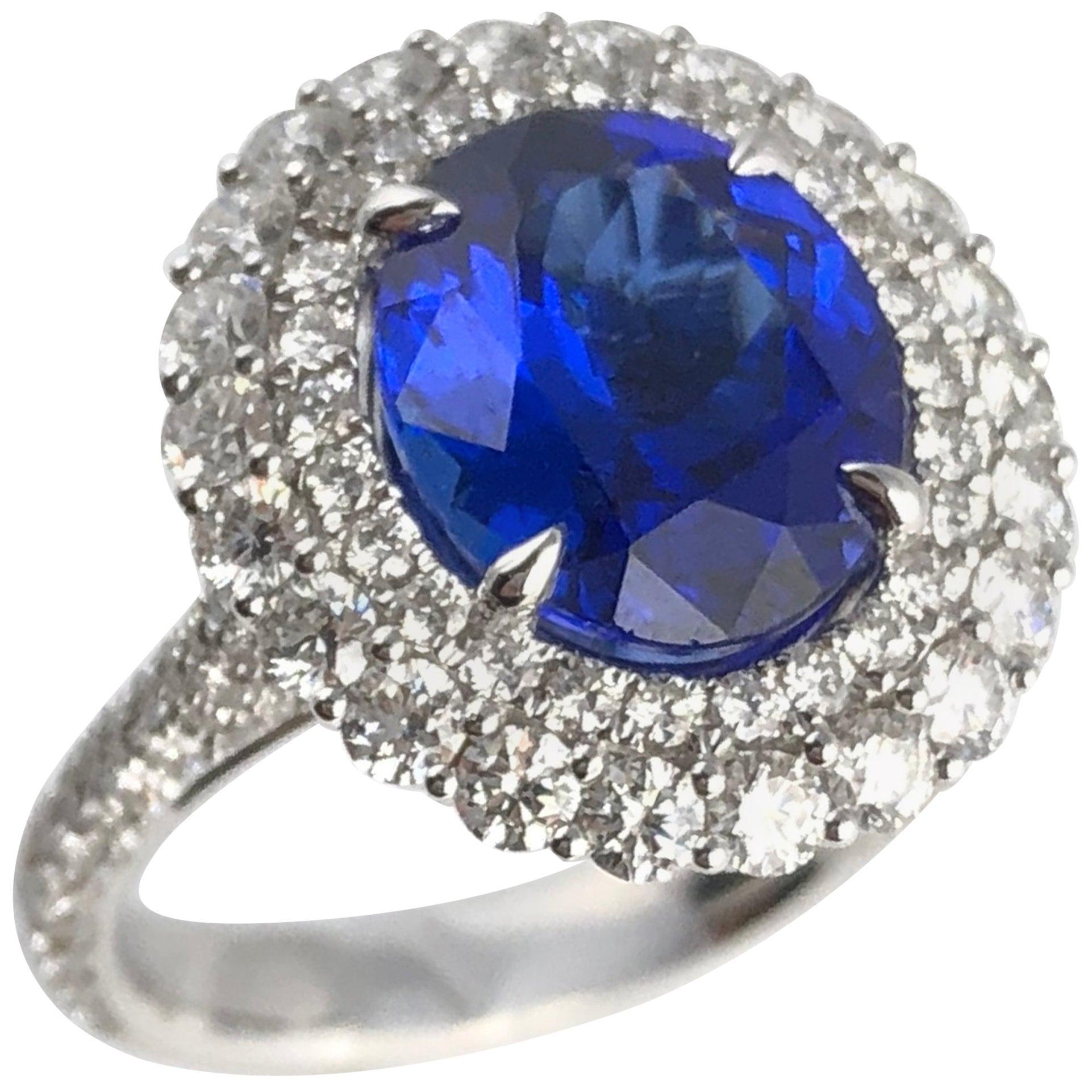 DiamondTown 4.64 Carat Oval Cut Tanzanite and Diamond Halo Ring