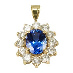 2.87 Carat Oval Tanzanite and Diamond Yellow Gold Pendant