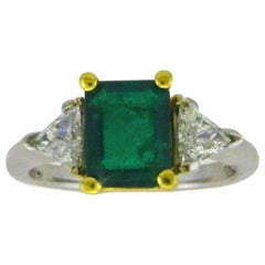 Three-Stone 18 Karat White Gold Emerald Cut Emerald and Diamond Ring